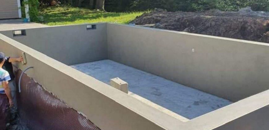 AGJ CONSTRUCTION – Faire construire un piscine enterrée à Petite-Île